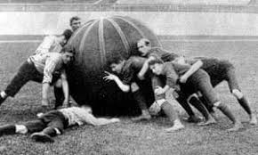 behavior change - men pushing large ball